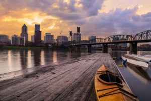 Portland, Oregon Panorama. Sunset scene with dramatic sky and light reflections on the Willamette River.